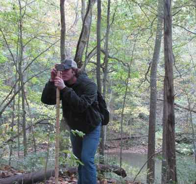 Student Shawn Courtney is measuring a stratigraphic section in southern Ohio for a Biostratigraphy class project (Fall 2011).