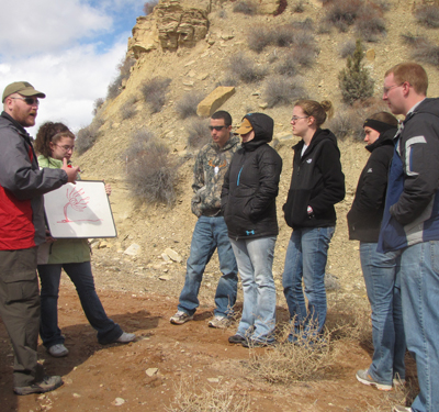 Dr. Tom Muntean explains the stratigraphy and fossils that are exposed at this outcrop in southern Utah to the US Field Experience Class (Spring 2012).