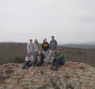 The Igneous and Metamorphic Petrology class hiked to the tp of the Devils Honeycomb trail in the St. Francois Mountains, southern Missouri. Here, spectacular columnar jointed rocks formed as the rhyolite laval flows were cooled (Spring 2011).