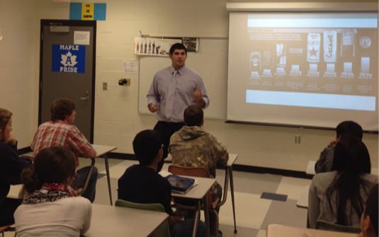 R.J. Rios, a teacher education student majoring in physical education with a minor in heatlh, and assistant professor Al Craven taught Adrian High School students about the life of an athlete and the latest brain research related to their overall health. R.J. is pictured above teachin