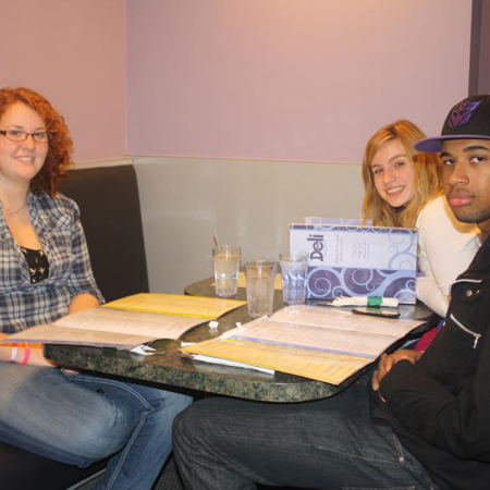 Stephanie Boehringer, Britnee Basch and DaVante McCollum dine after visiting the Holocaust Center.