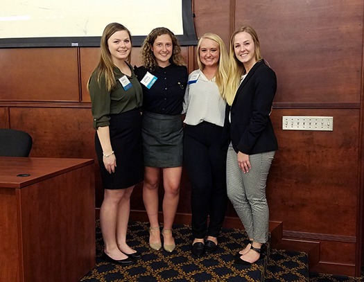 "Accounting students Mady Crandle, Lily Brueckman, Casey Cribbs and Mariah Kramer researched an emerging accounting topic for presentation at the Ribbons of Excellence Conference. Their research, titled ""Sustainability Accounting: Balancing People, Profit and Planet,"" centered around the question, ""Do accountants have the ability to make or break the planet?"" Their research provided a background on sustainability accounting and provided examples of several forms of sustainability reporting. They identified the differences between Corporate Social Responsibility, B-Corps and Sustainability Accounting. Additionally, the students highlighted Coors Brewing Company and their efforts toward achieving sustainable business practices."